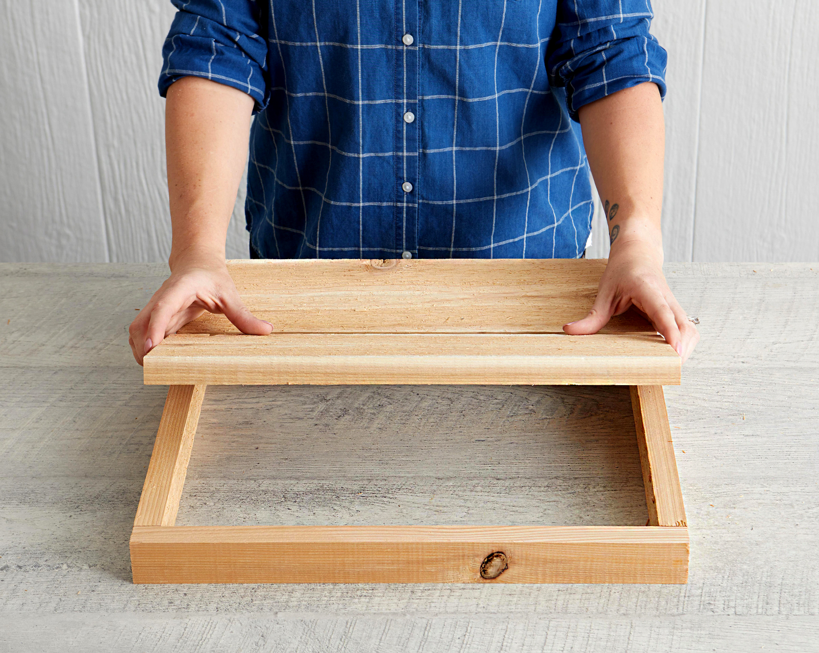 place three boards on top of frame