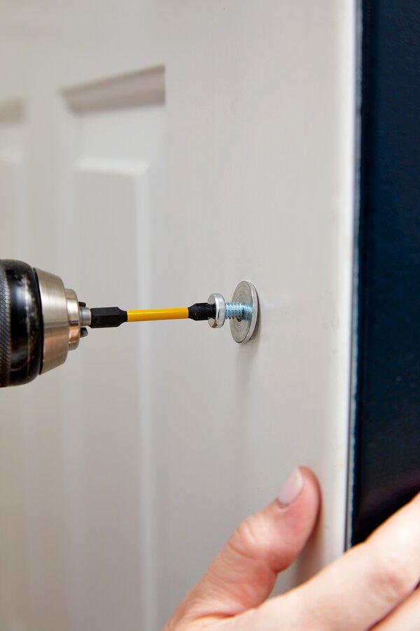 add metal hardware to interior door
