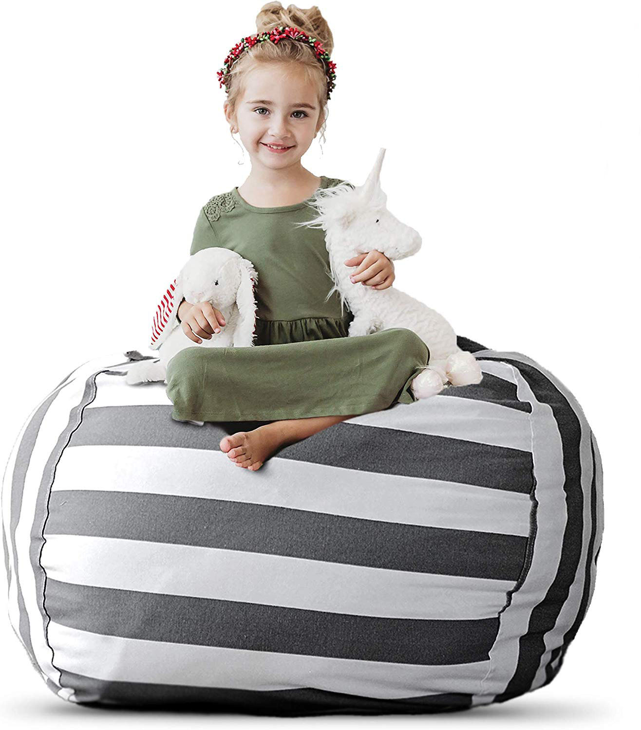little girl on a bean bag chair with stuffed animals