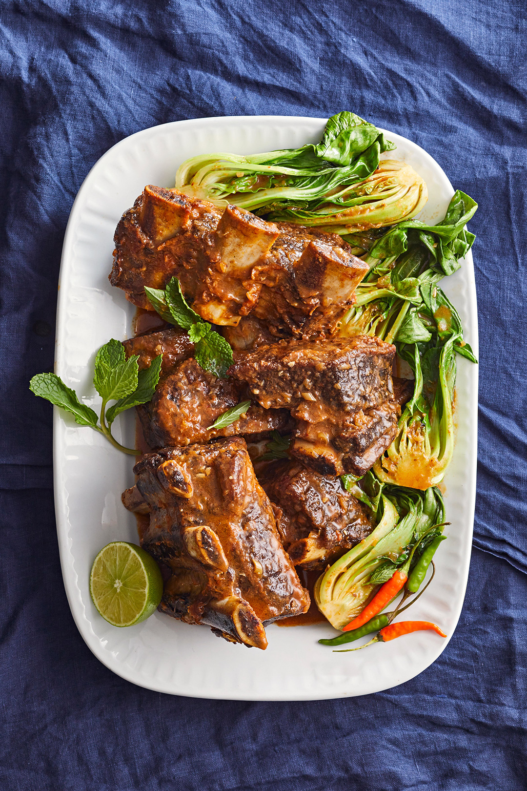 Coconut-Curry Short Ribs with lemons peppers and cabbage