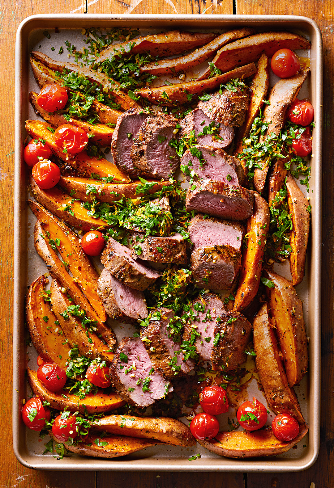 Sheet Pan Beef & Sweet Potatoes with Gremolata on wooden table top