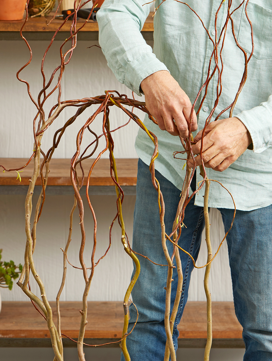 wrapping willow branches together and tying them