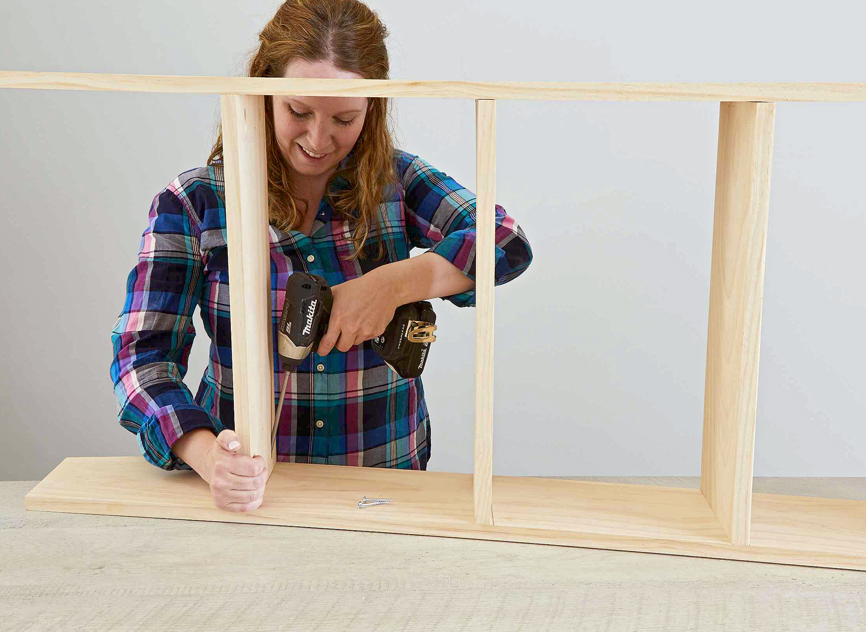 use screwdriver to attach ladder steps