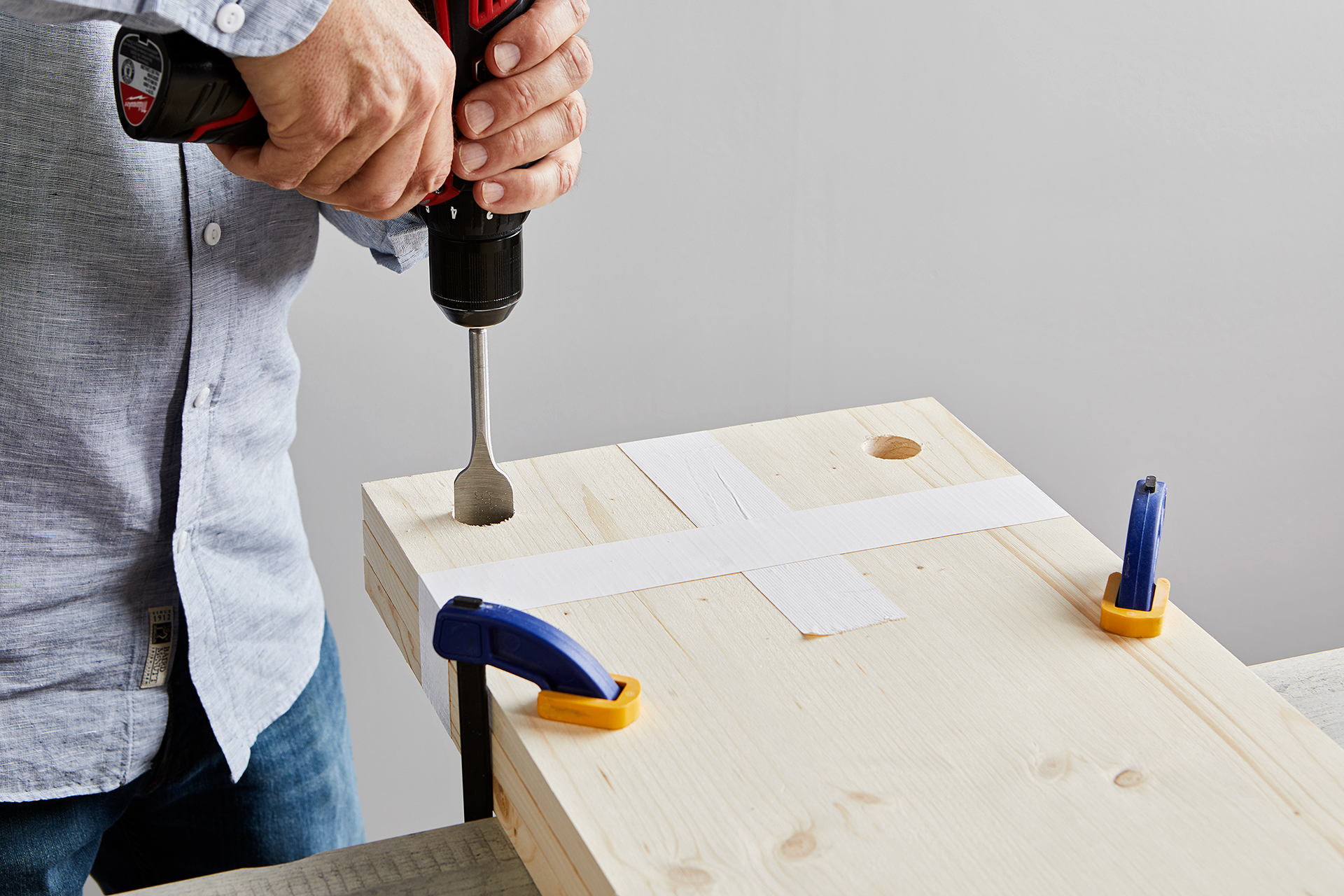drill holes into boards attached together