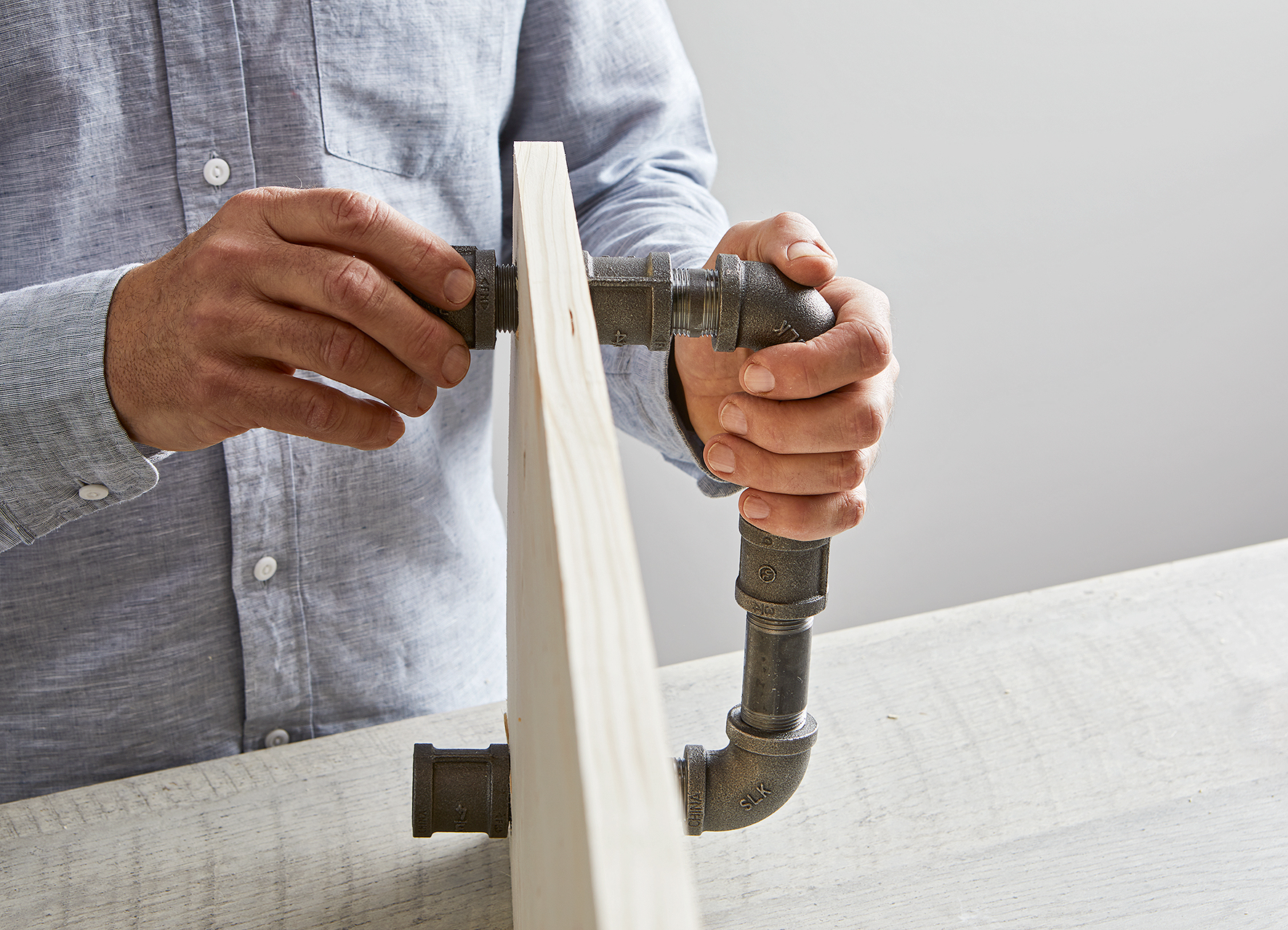 add couplings to pipe to secure handle