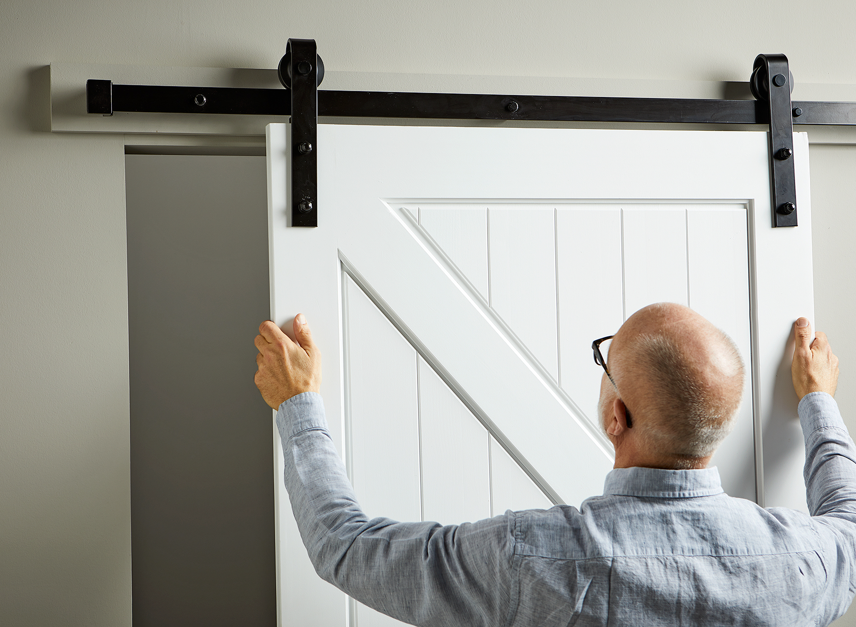 hang barn door on track hardware