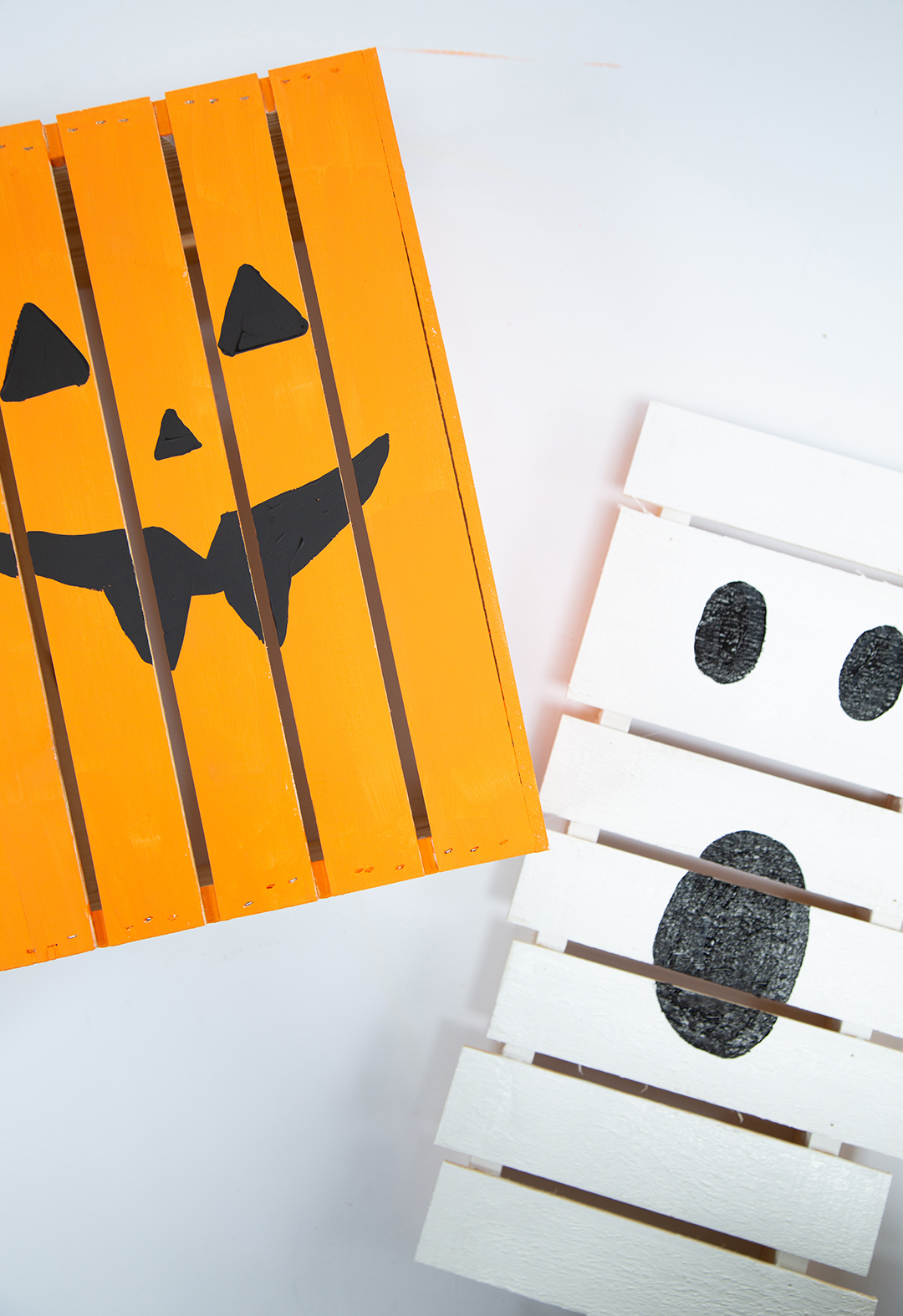 orange and white halloween painted pallets