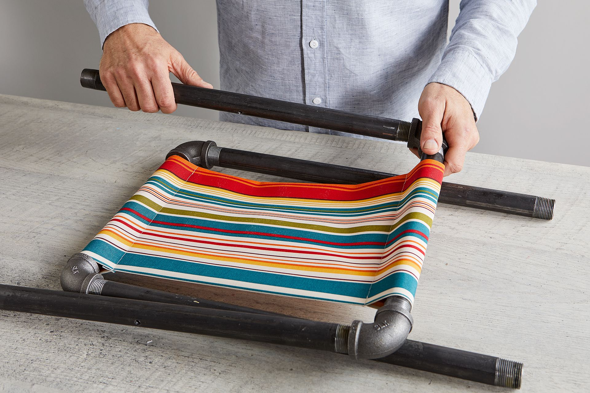 attach pipes to elbows for fabric stool