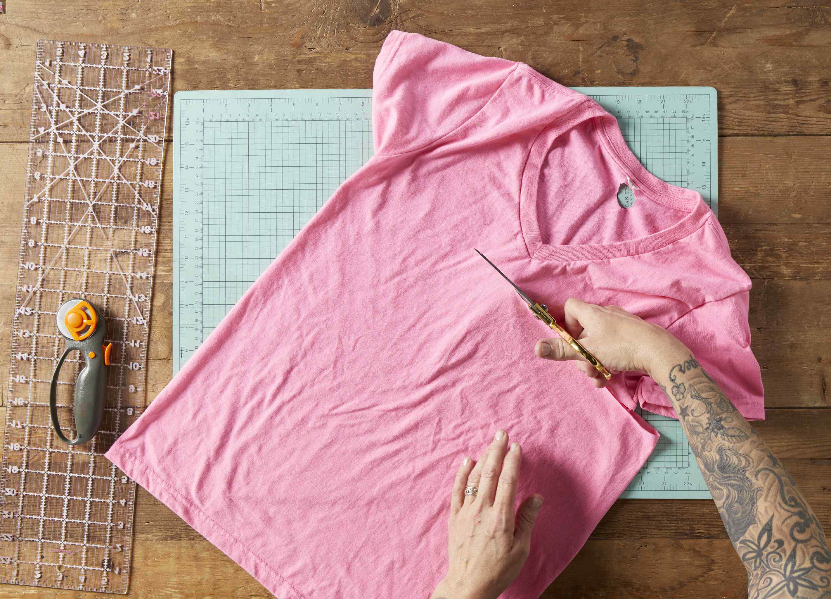 Cutting a pink shirt for a DIY dog toy