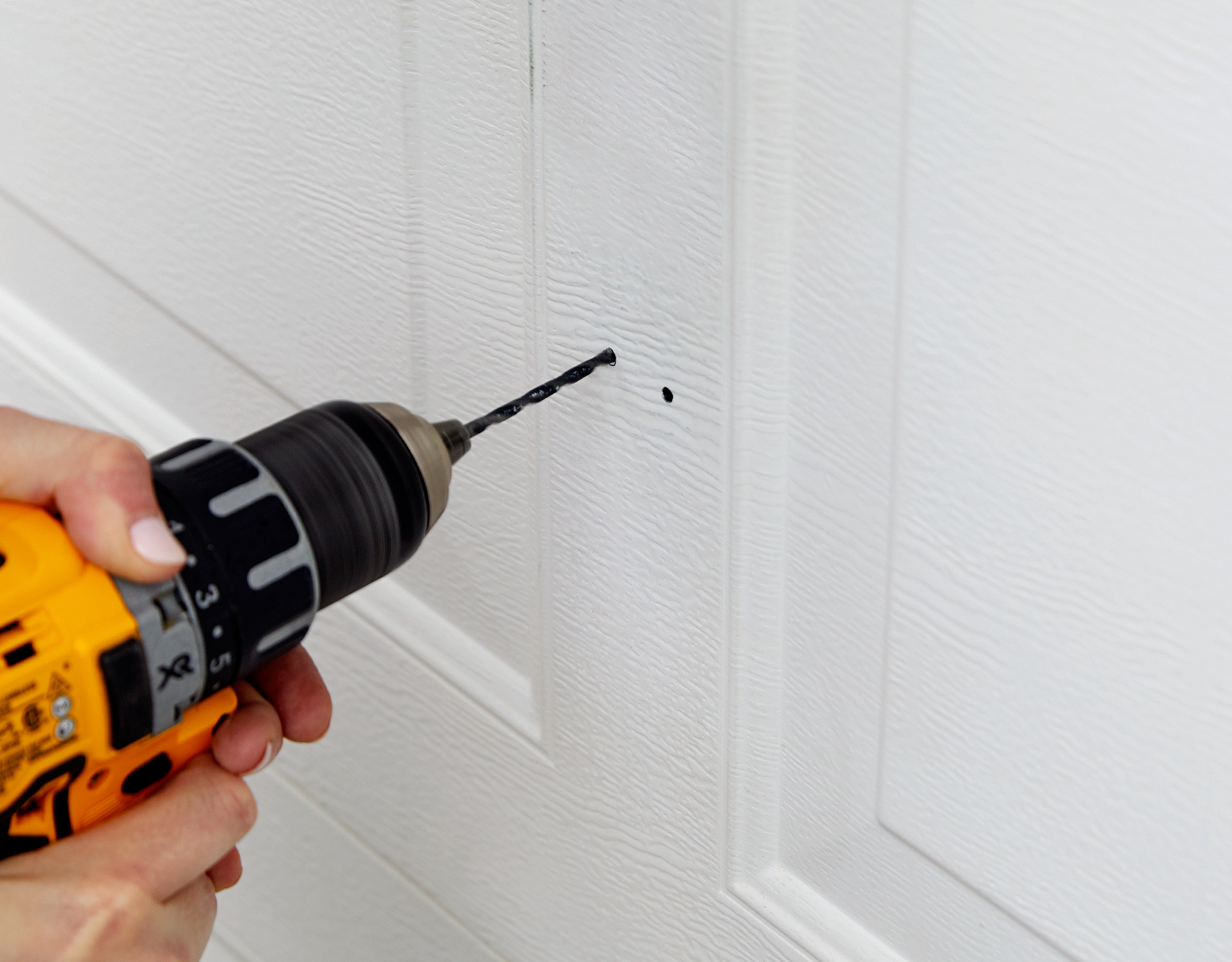 add additional pilot hole for handle