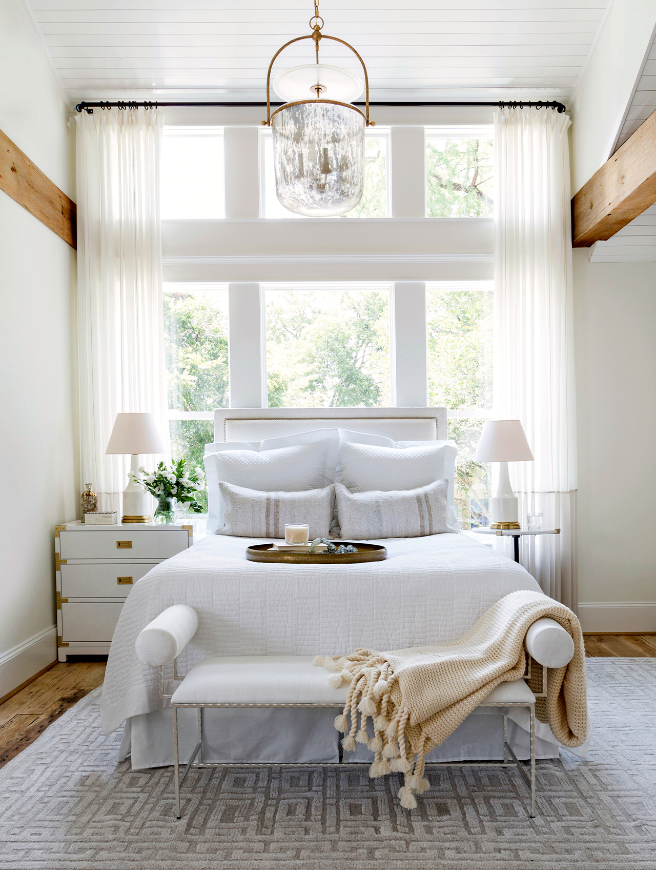 corner of living space with airy bedroom nook
