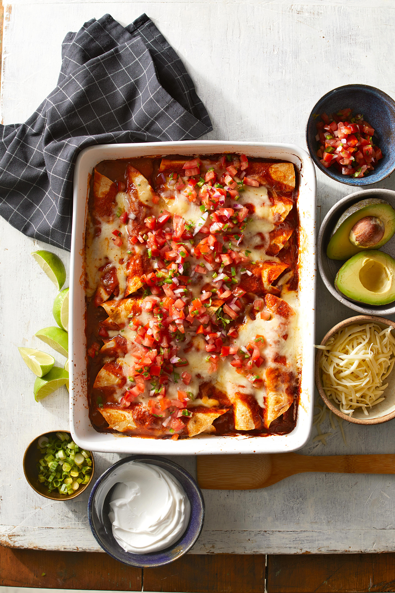 Beef Enchiladas with toppings on board