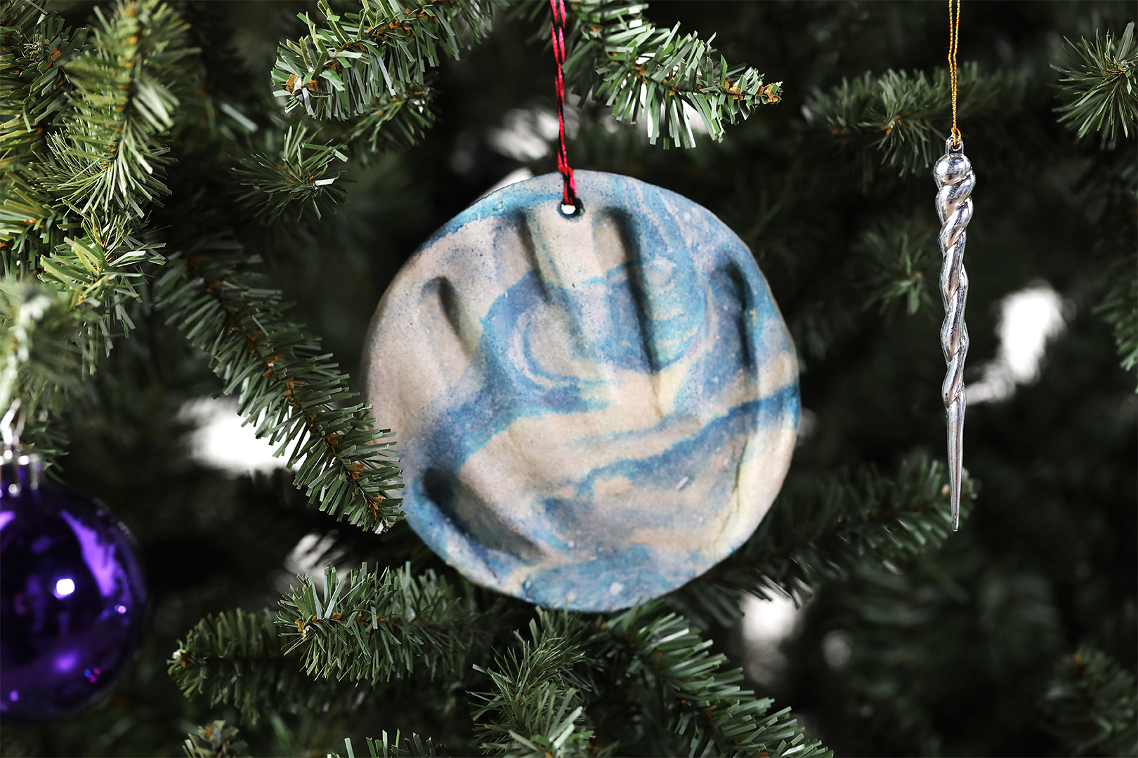 Footprint Christmas Ornament blue and white swirl handprint