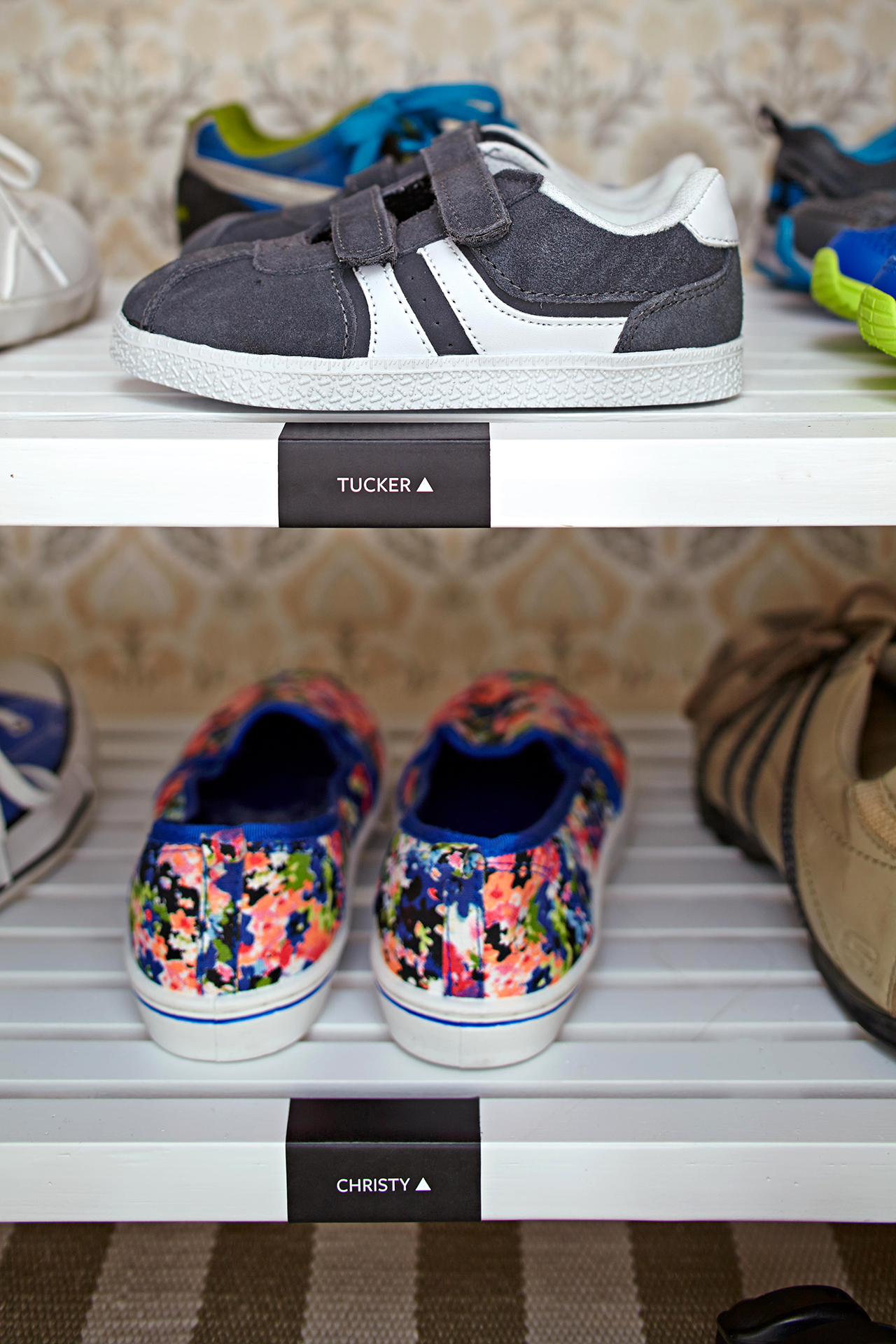 childrens shoes on labelled shelves