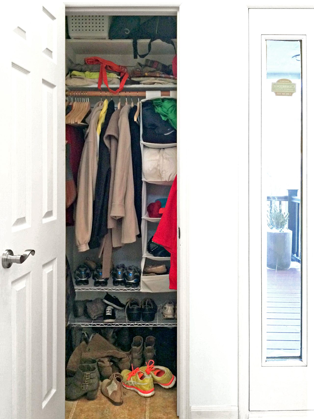 front closet in white entry way