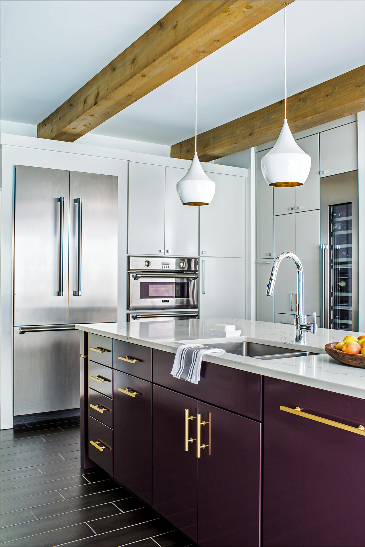 high ceiling white and gray kitchen with eggplant cabinets