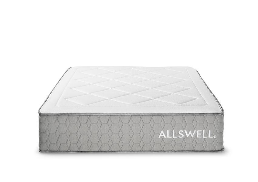Mattress from Allswell with gray tufted sides and white tufted top