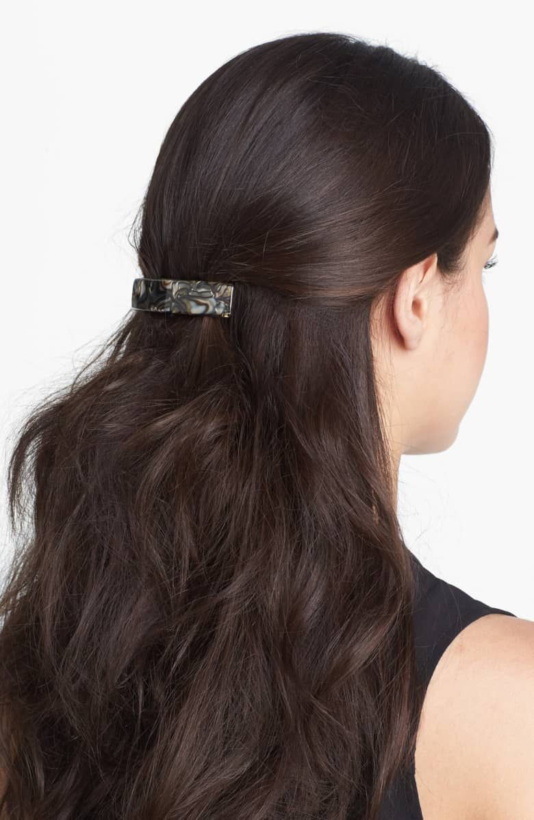 Brunette woman with barrette in hair