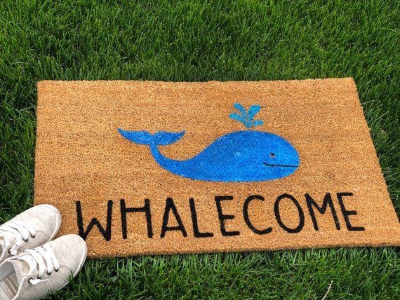 """Doormat with a whale that says """"whalecome"""""""
