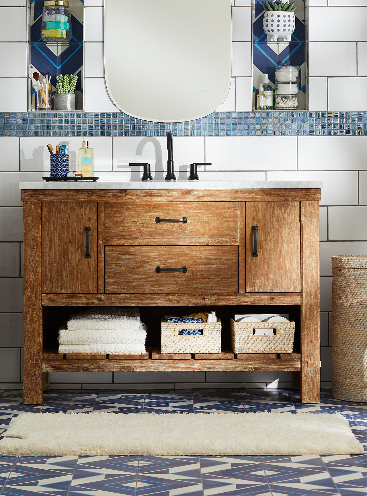 bathroom sink with blue tile flooring and wood shelving