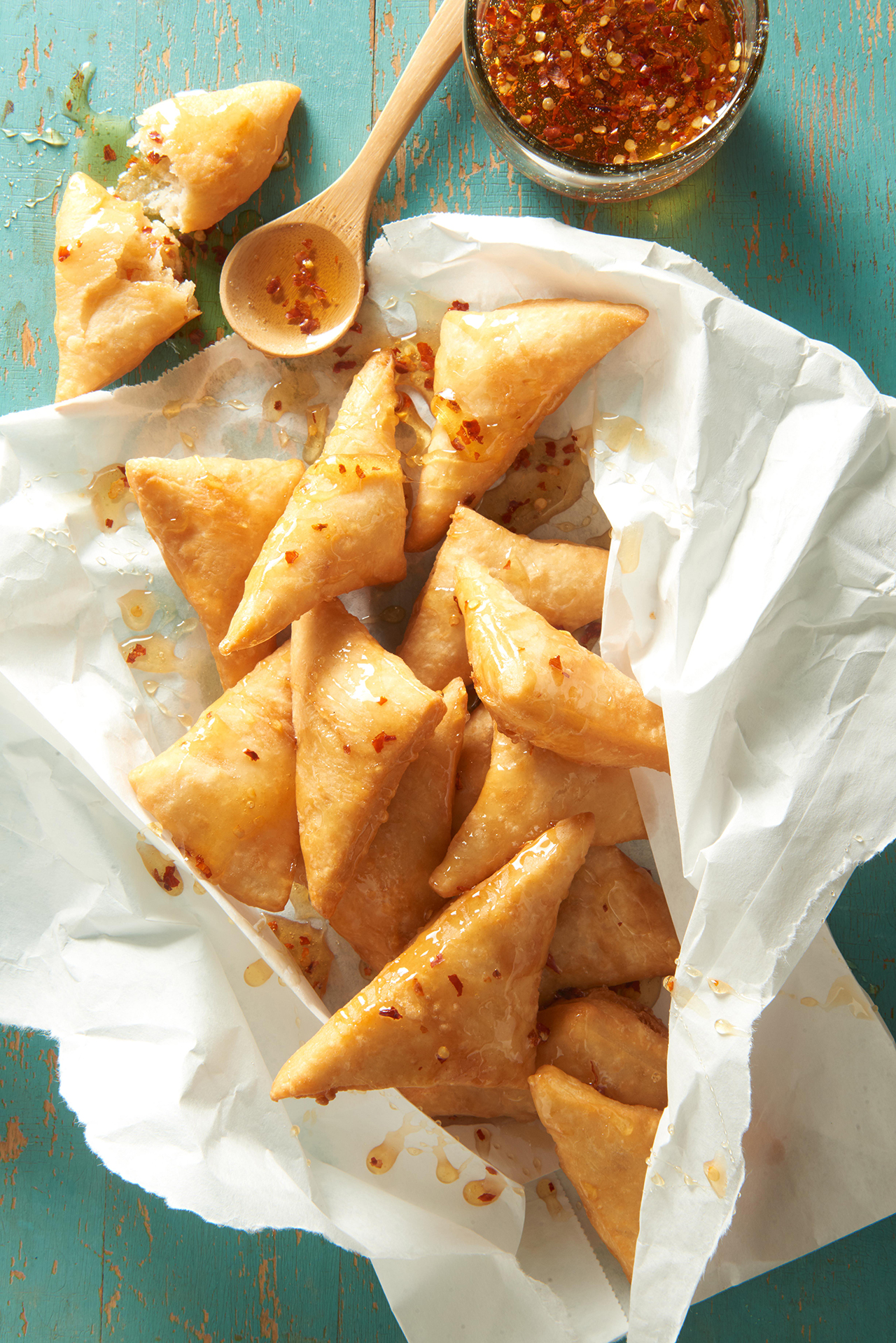 Sopapillas with Spiced Honey wrapped in parchment paper