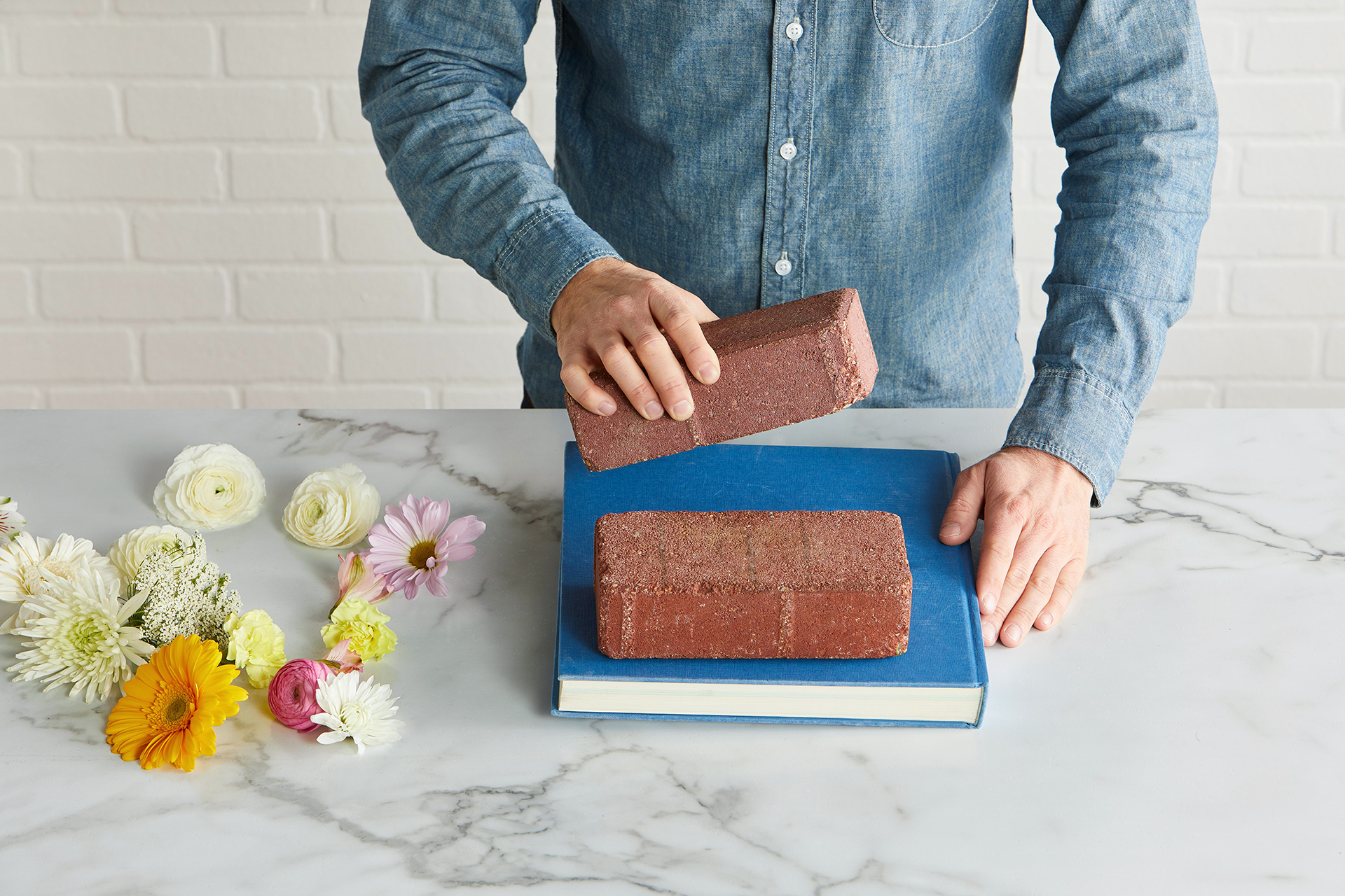 bricks and blue covered book used to press flowers