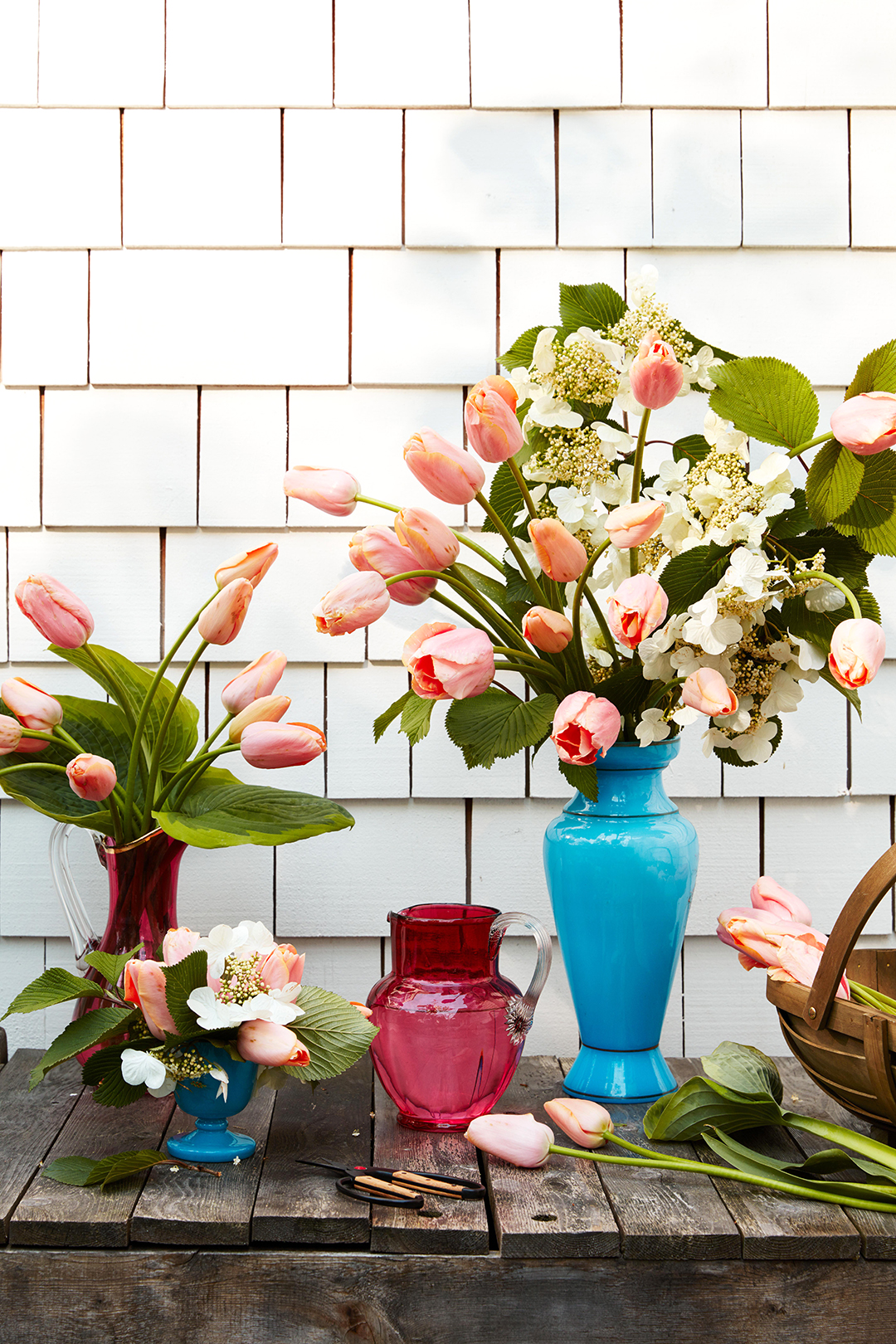 bouquets of tulips on wooden table