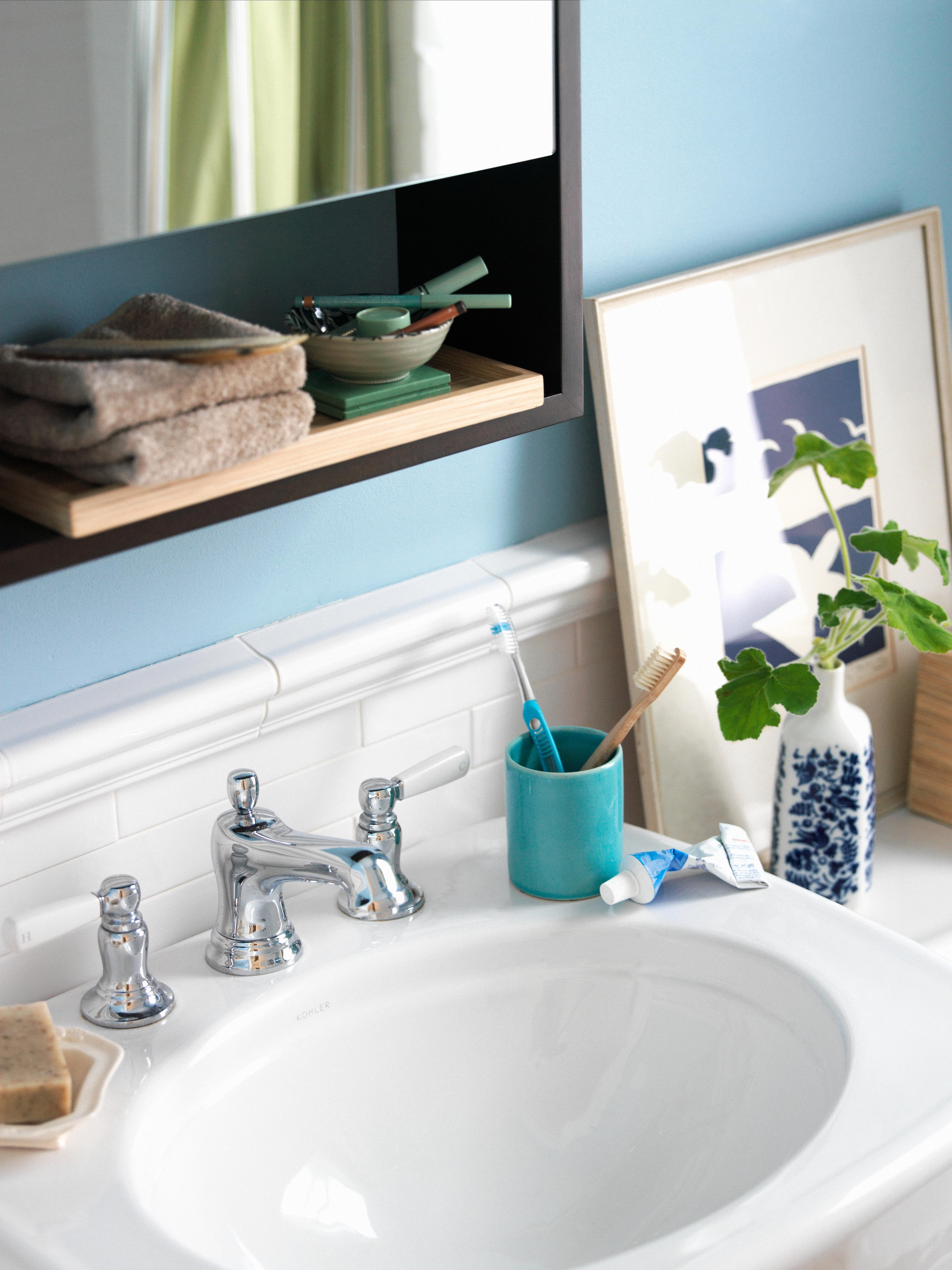 blue painted bathroom vanity sink with toothbrush holder