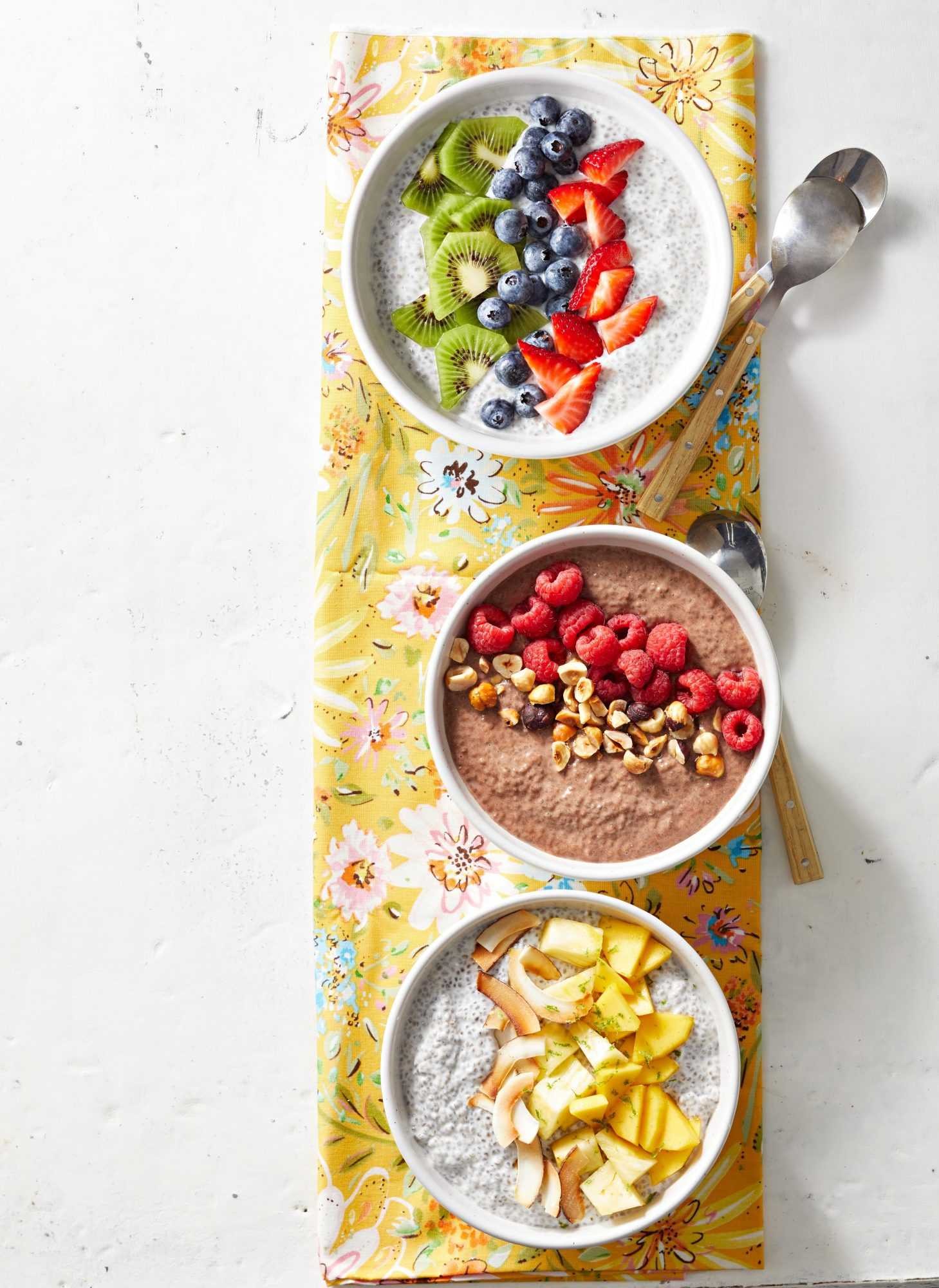 Basic Chia Pudding bowls with sliced fruit and nuts