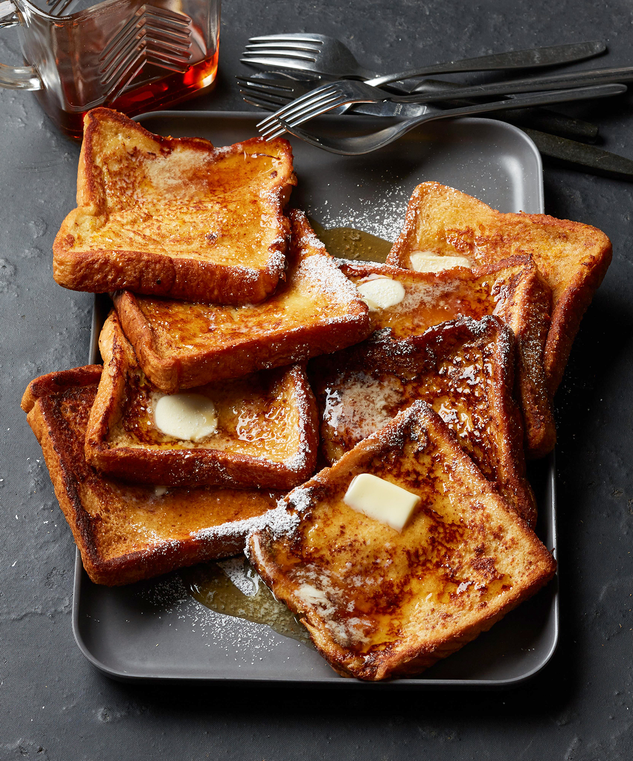 Classic Homemade French Toast Topped with Butter and Syrup