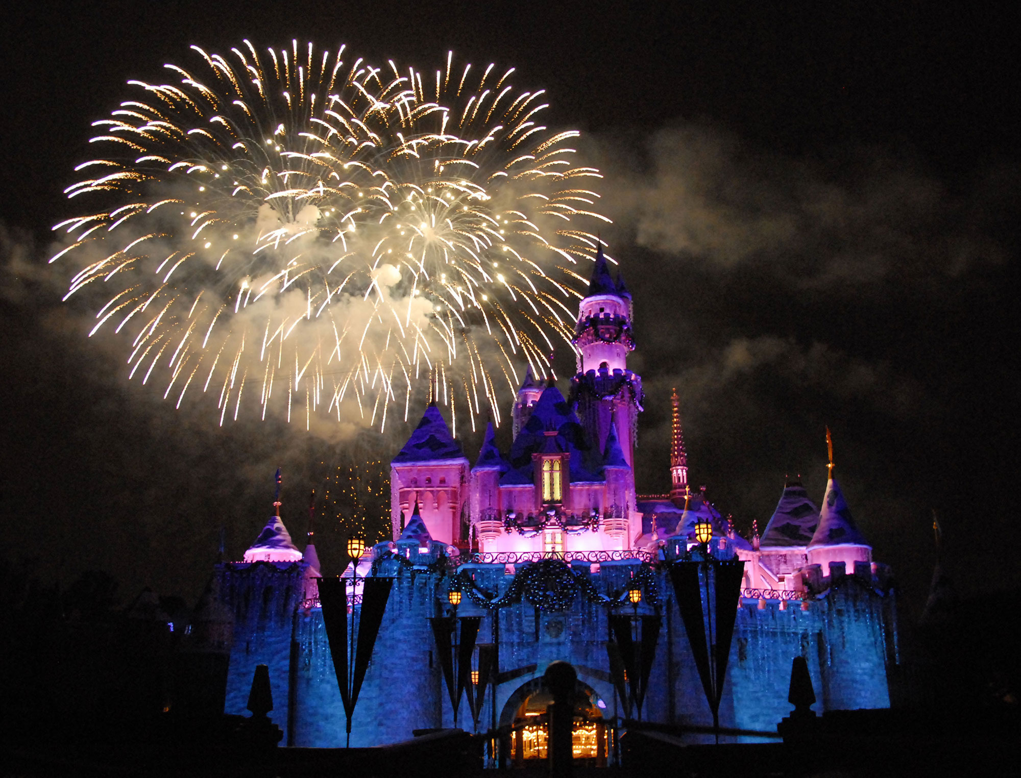 Disney land castle at night with fireworks