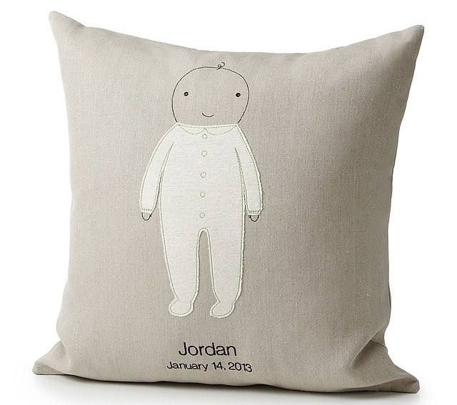 pillow with embroidered baby