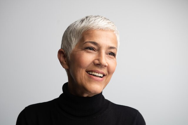 Mature woman with pixie haircut.