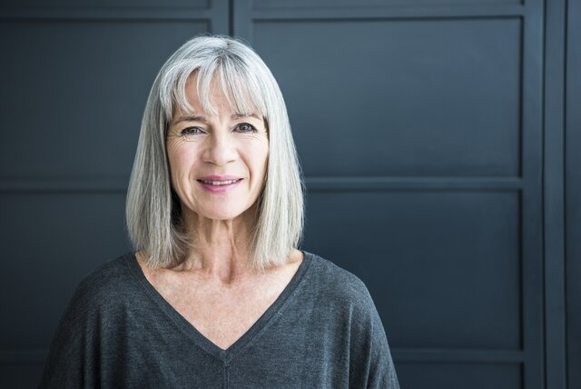 Mature woman with lob haircut with bangs
