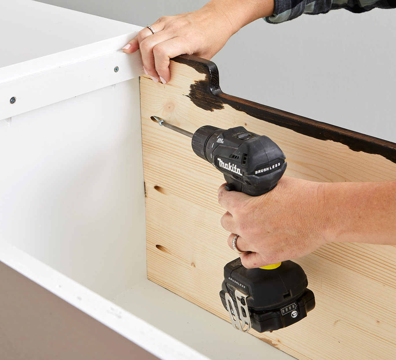 screwing stained wooden board into white board