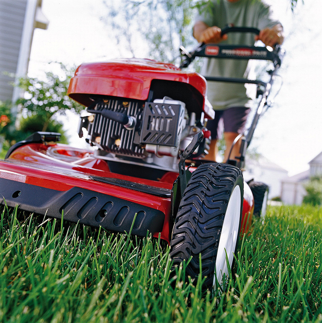 red lawn mower in grass
