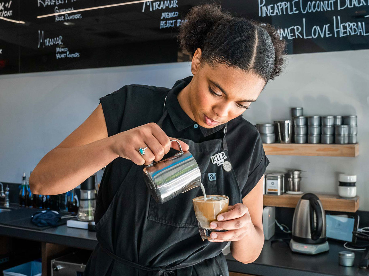 young woman pouring coffee