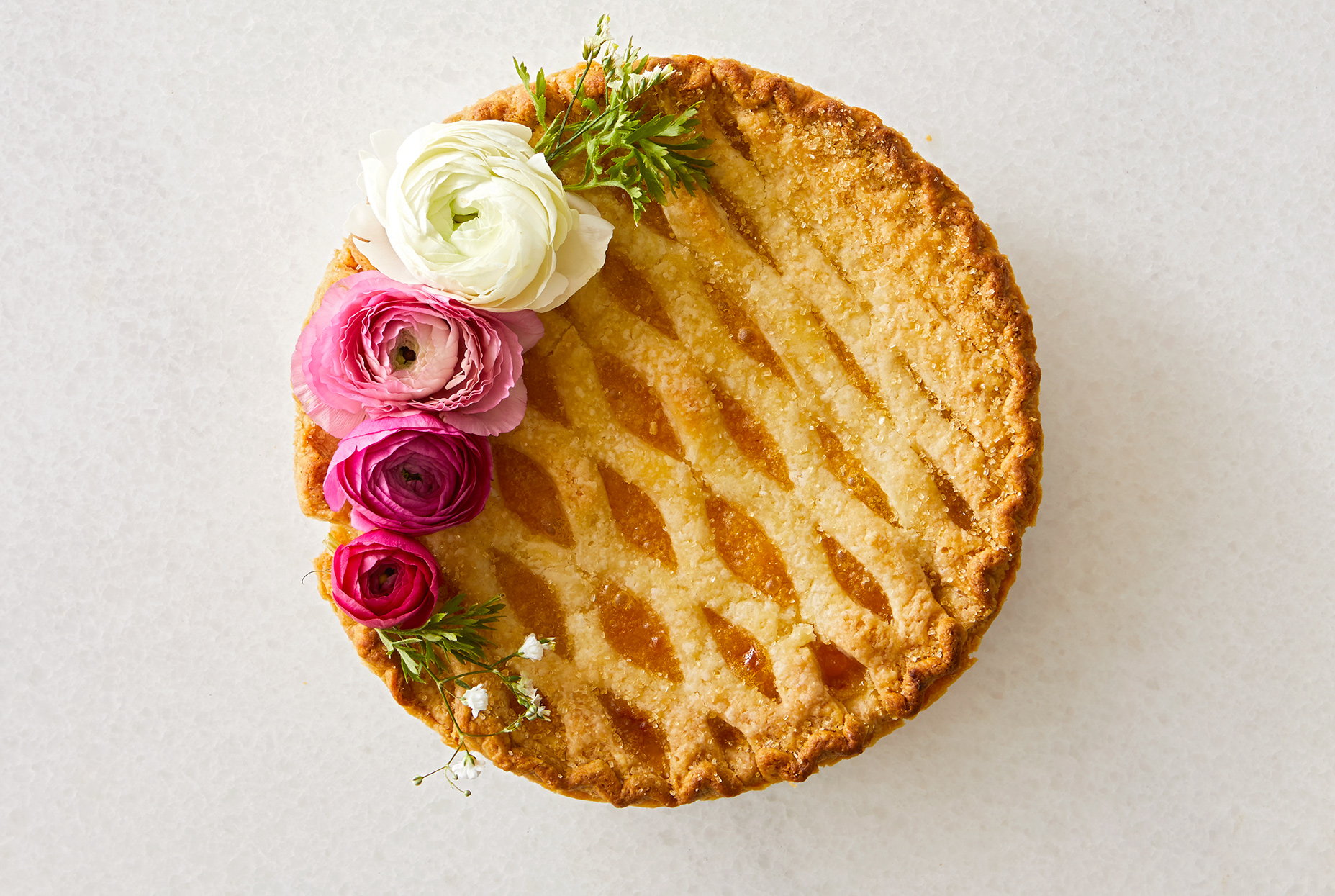 pie topped with pink red and white flowers