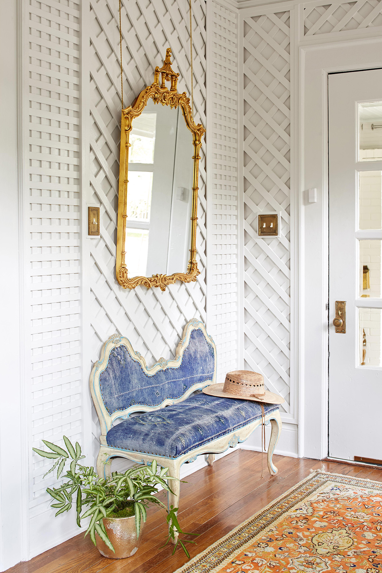 Mirror above entryway bench
