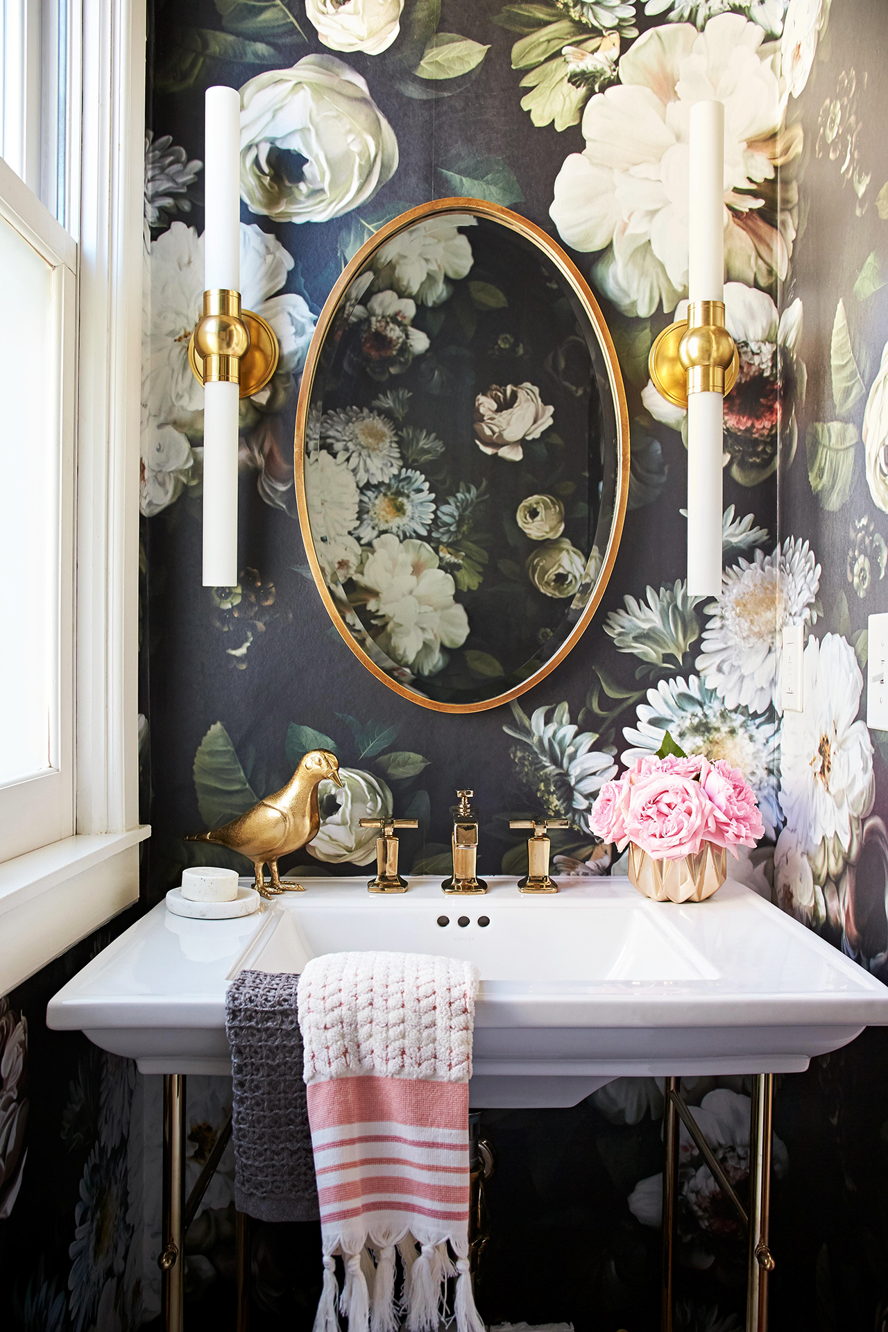 bathroom with dark floral wallpaper and white sink