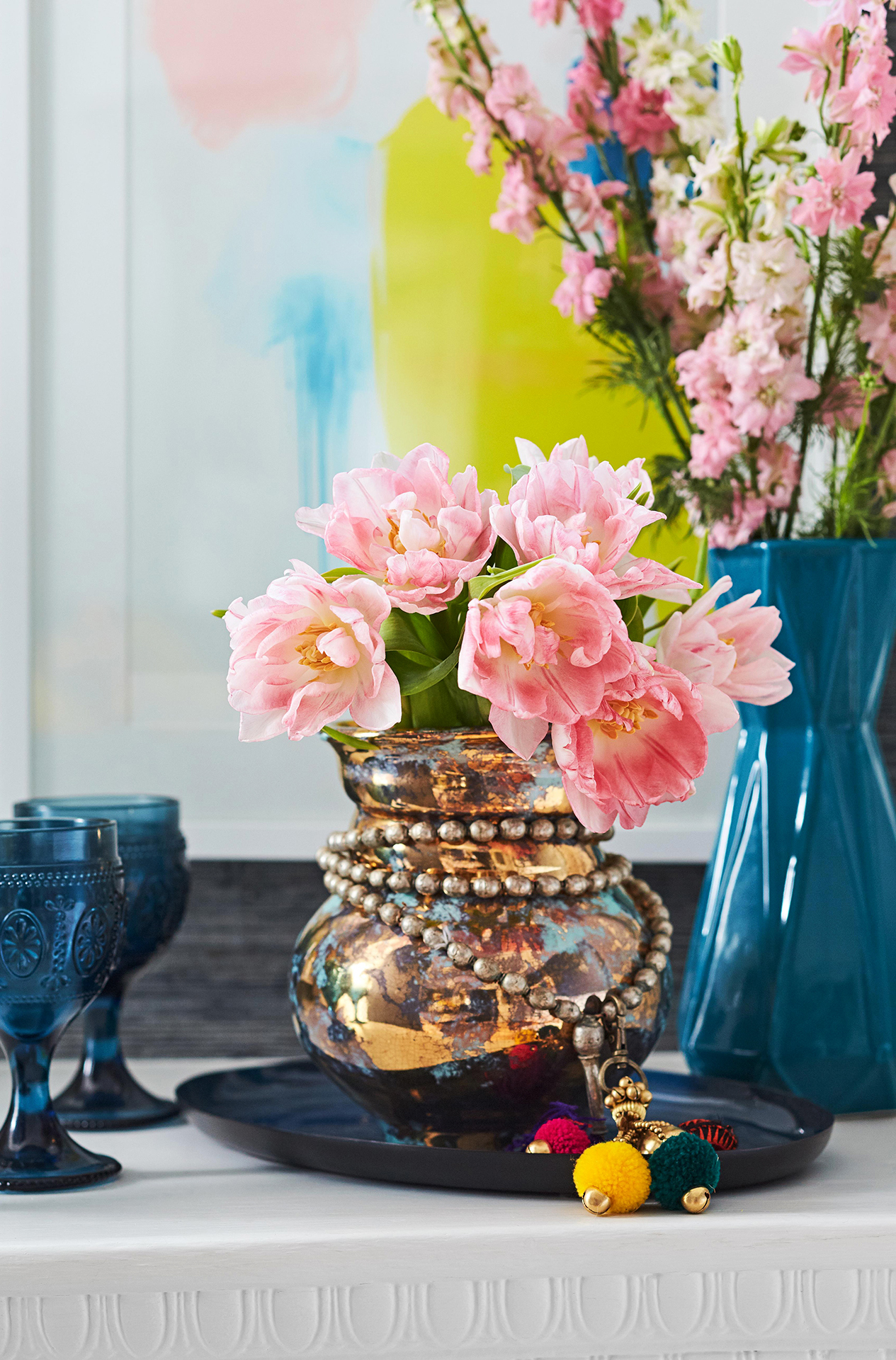 close up of pink flowers in metal vase