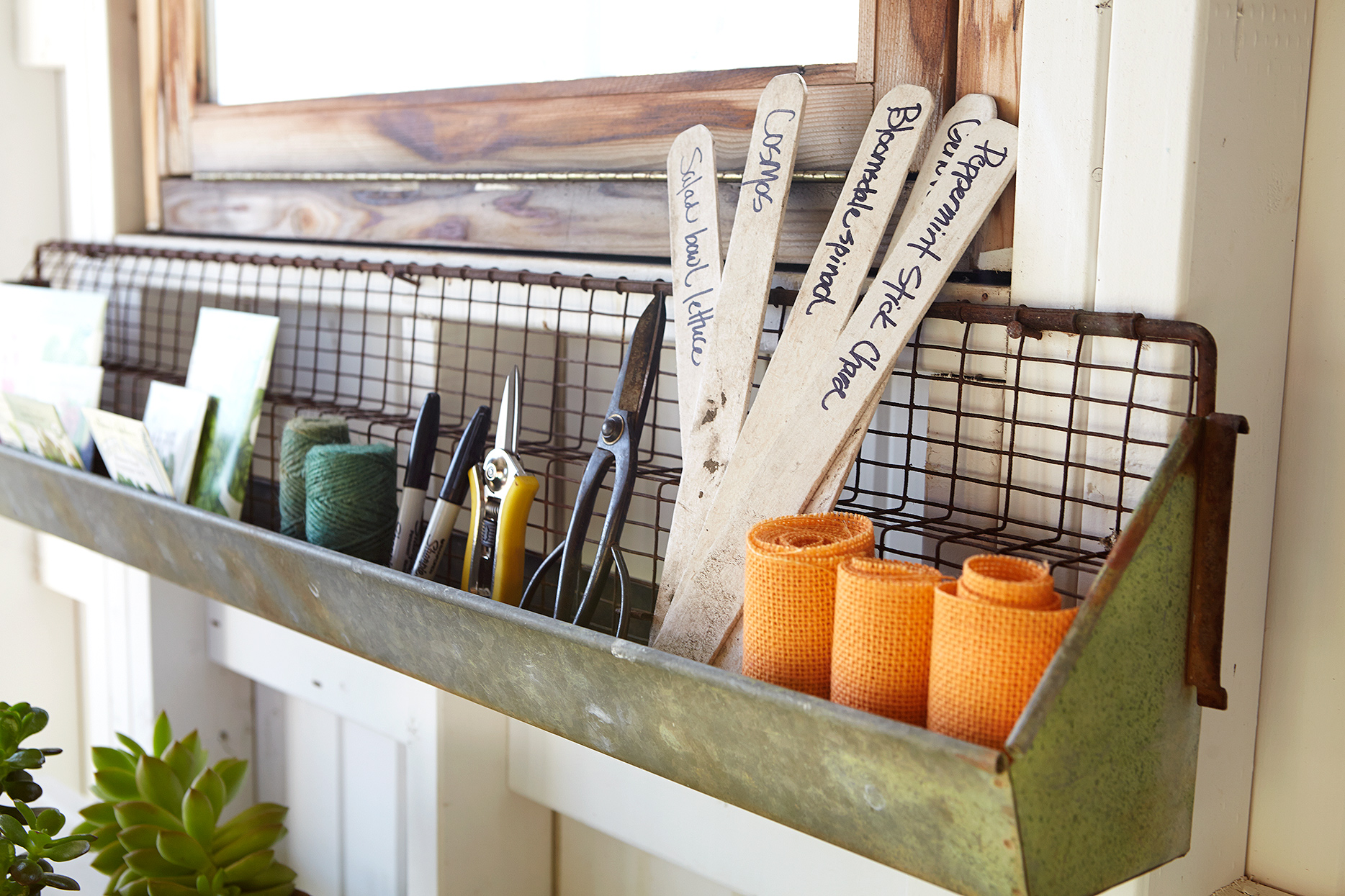 wood seed markers on rustic shelf