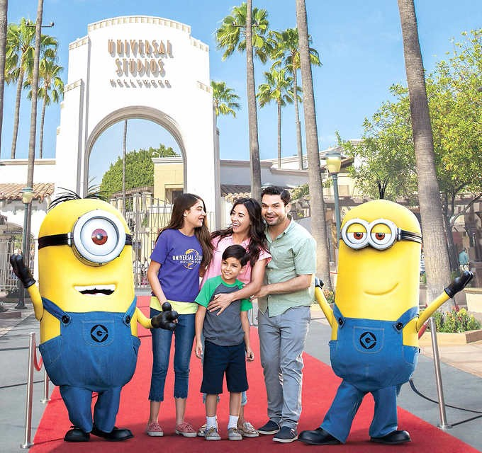 Family of four stands with minion characters outside universal studios hollywood