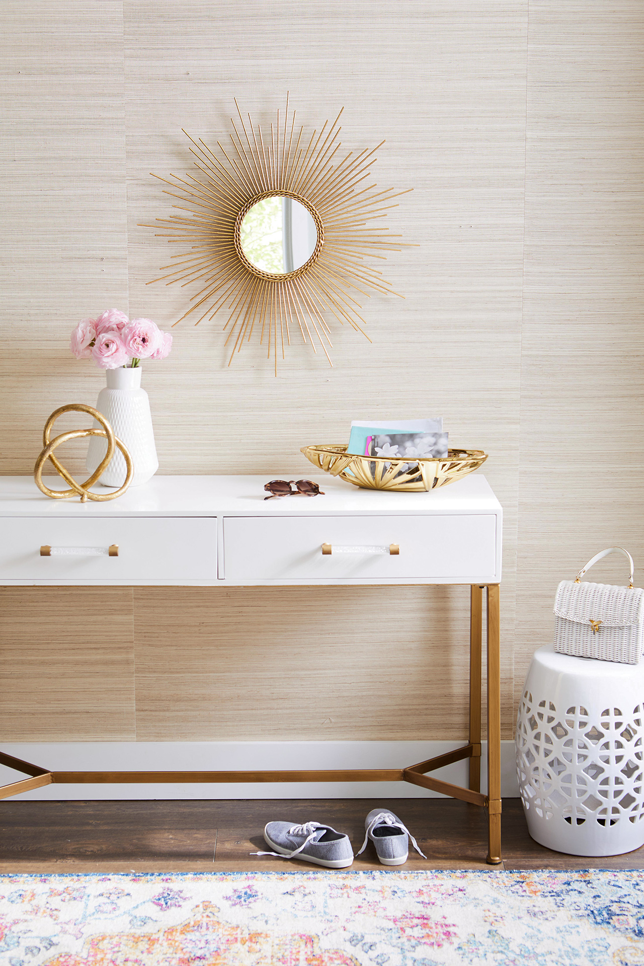 white table top with drawers with gold and white home decor