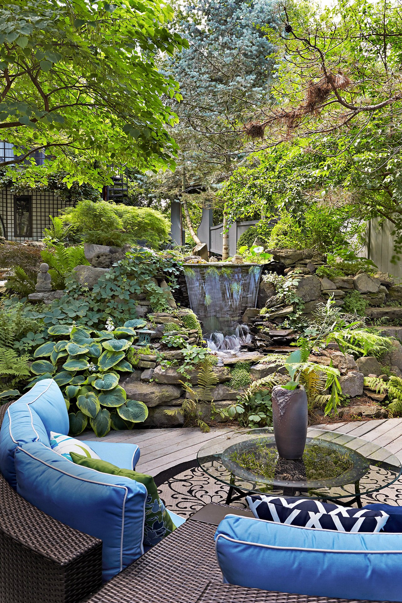 asian style garden waterfall out door seating area