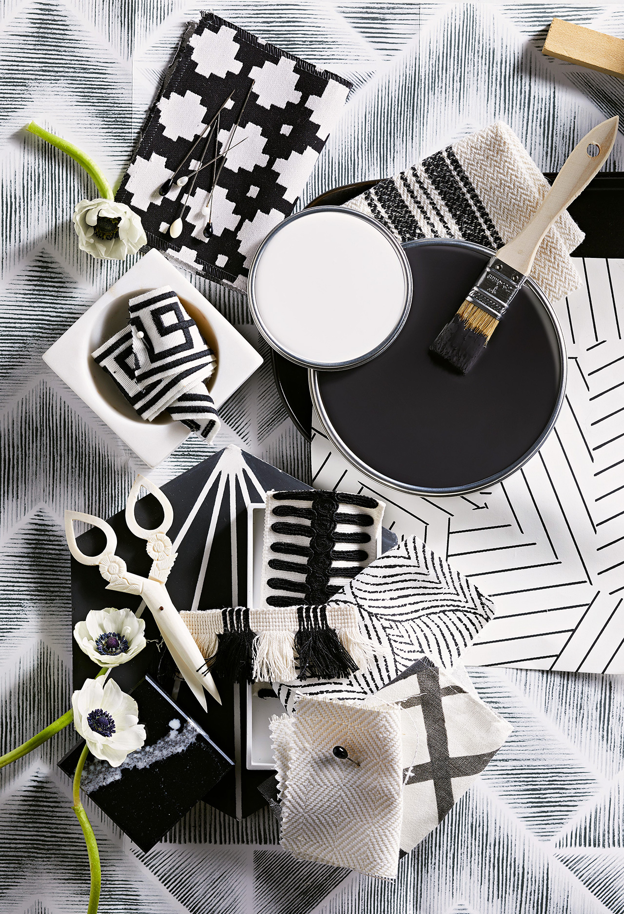 various black and white crafting material and white flowers
