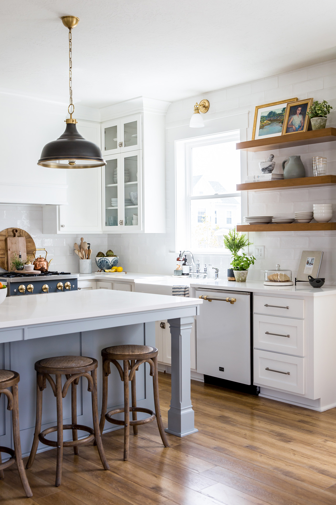 white gray kitchen with wood flooring open shelving