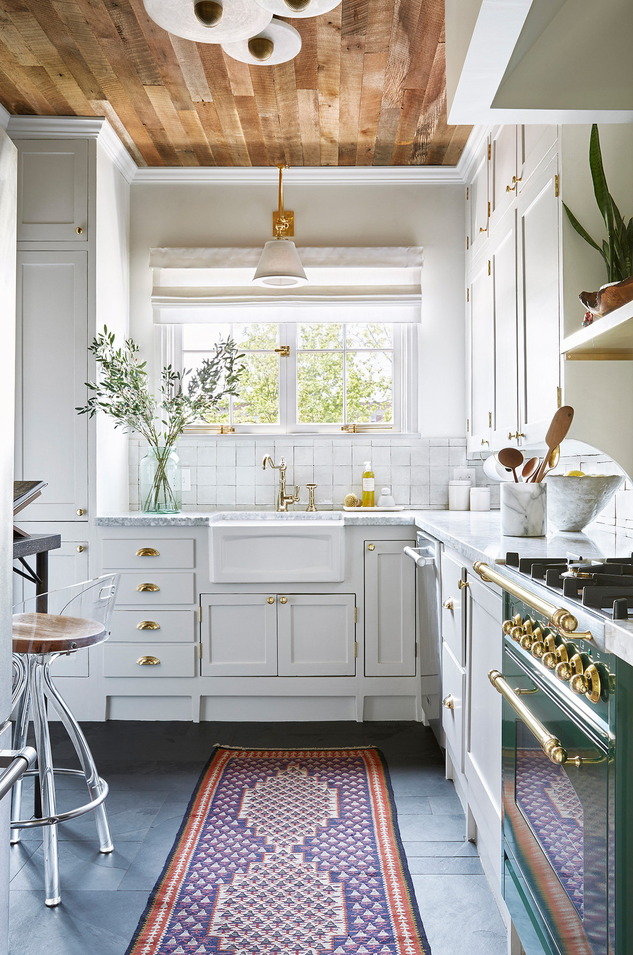 white kitchen with wood ceiling dark green oven