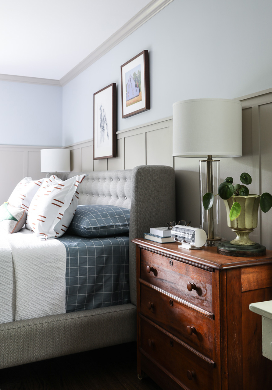 gray blue bedroom with wood dresser