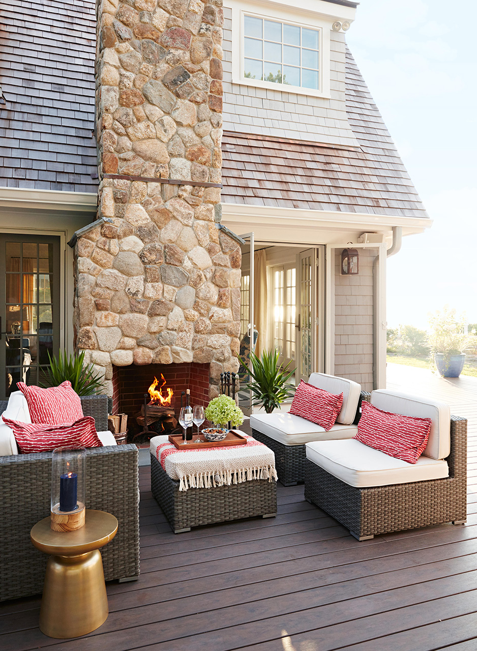 back deck sitting area with outdoor fire place